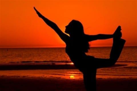 woman yoga on beach sunset Medium