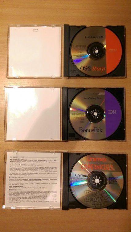 ibm_os2_warp3_opened_cd.thumb.jpg.1a982789b4a46bf2d45b37ede1af801d.jpg